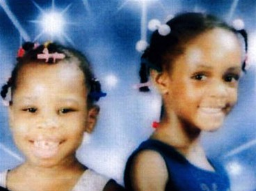 Adopted daughters Minnet Cecila Bowman, left, and Jasmine Nicole