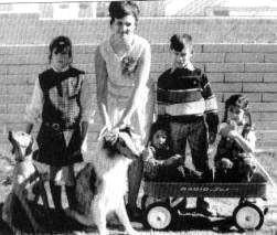 Andrew seated on cart with mother and siblings gamma liason andrew