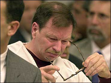 Gary ridgway listens to a victim s family member address the court