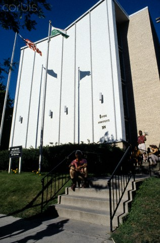 Residents Sit Outside The Apartment Building In Milwaukee Where Serial Jeffrey Dahmer Ed Most Of His Victims